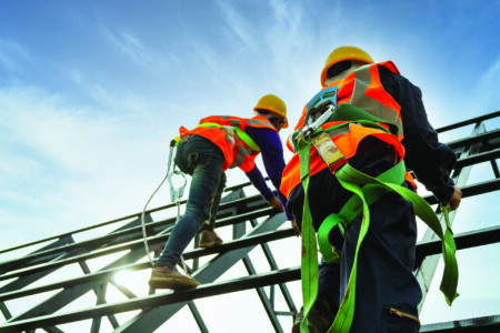 workmen in harnesses working at height