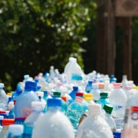 plastic bottles and plastic products on a conveyor belt